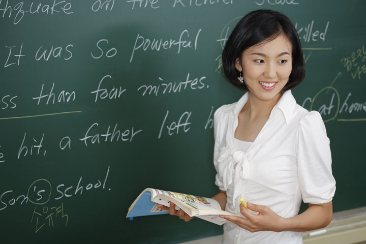 tesol teacher in front of black board